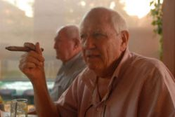 Ran Janoff, 81, smokes about six or seven $4-$5 cigars per week and says the 40-cent per cigar price hike is unlikely to deter him. Photo: Xavier Gallegos/Tucson Citizen