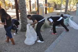 Youth picked cigarette buts from METRO Light rail stations.