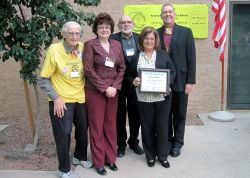 Health Leadership Award recipient Gladys Cedillos is joined by OTCDP Office Chief Laurie Thomas and ACAS members.