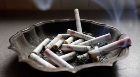 In this Saturday, March 2, 2013 photo, a cigarette burns in an ashtray in Hayneville, Ala. (AP Photo/Dave Martin)