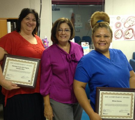 Gladys Cedillos, community development specialist at the Maricopa County Office of Tobacco & Chronic Disease Prevention (center), recently presented Glendale WIC Site Supervisor Michele Giovanniello (left), and Miriam Herrera, CNW (right) with awards for referring the most clients to the Arizona Smokers' Helpline (ASHLine).