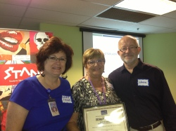 Laurie Thomas and Sue Bergquist from Maricopa County Office of Tobacco and Chronic Disease Prevention Accept their Award of Excellence.