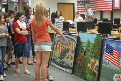 Middle schoolers view the exhibition.