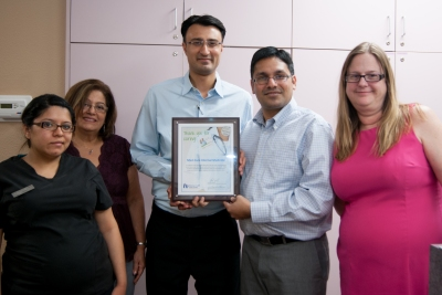 The staff at Med-Cure Internal Medicine with their award.