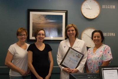 Scottsdale Center for Advanced Pain Management staff accept their Top Referer Award.
