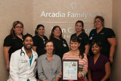 Staff from Arcadia Family Clinic receive their award.