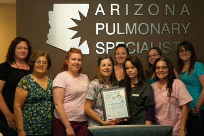 The staff at Arizona Pulmonary Specialists accepts the award.