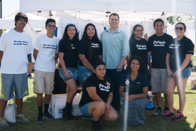 State representative Mark Cardenas (D-19, Center) and Vania Guevara from Phoenix City Councilman Daniel Valenzuela's office (lower right) Pose with Youth Coalition members.